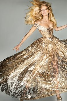 BRITAIN's leading supermodels teamed up with the country's brightest design stars in the September issue of Vogue for one of the magazine' all-time most exciting and glamorous photoshoots, Midas Touch, part of the London 2012 Closing Ceremony.