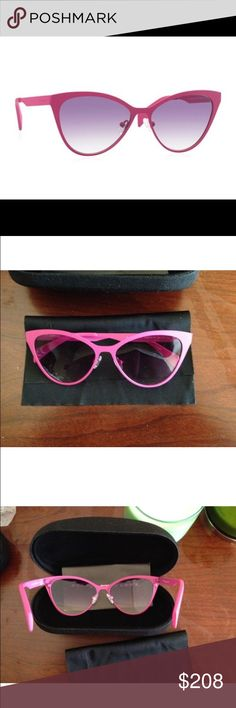 """ITALIA INDEPENDENT  Pink CatEye Sunglasses Hand-crafted in Italy,  Italia Independent's pink metalcat eye sunglasses - ITALIA INDEPENDENT seals its status as a designer of """"unabashedly luxurious"""" sunglasses with these cat eye frames crafted from hot pink metal with dark black fume lenses. Finished with elegantly narrow matte pink metal arms  SIZE & FITTHIS ITEM'S MEASUREMENTS ARE: Eye: 55 Bridge: 15 Temple: 140 DETAILS Matte Pink Metal & Plastic Frames Black Fume  lenses 100% UV protection…"""