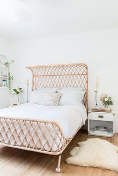 Bohemian bedroom with a rattan bed and a large rattan bed