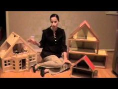 Choosing a Dollhouse to Incorporate into Play Therapy...Learning what is going on at home for the child.