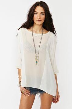 white sheer oversize top