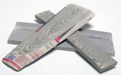 Newspaper hardened with resin to form solid material