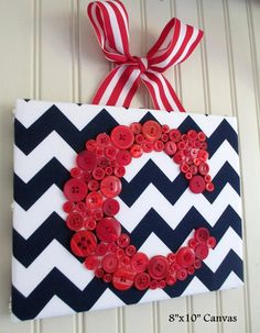 Why pay $60 for this when you could make your own?!  All you need is a canvas, some chevron fabric, some pretty ribbon, and buttons! LOVE. Instead of a wreath, hang this on your door.