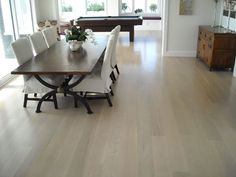 American Oak floor with a white stain and a matt moisture-cured polyurethane - a little green/yellow