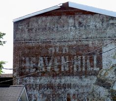 Vintage Old Heaven Hill painted sign in Louisville, Ky when the Old Heaven Hill 100 BIB was the largest selling brand in Kentucky 1950's