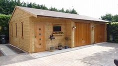 Triple Timber Garage with Recessed Roof, 2 Cedar Up and Over Doors, Felt Tiles and a Sienna Front Door
