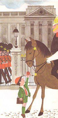 Little boy outside Buckingham Palace feeding one of the Horse Guards' horses.