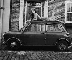 Charlotte Rampling,1967 on the set of The Avengers with an old school Mini coupe.
