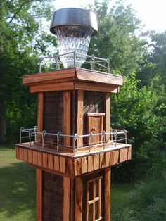 Solar Lighthouse Birdfeeder OOAK Custom by TheMomandPopWoodshop, $150.00 idea for diy birdfeeder exterior using standard tube feeder