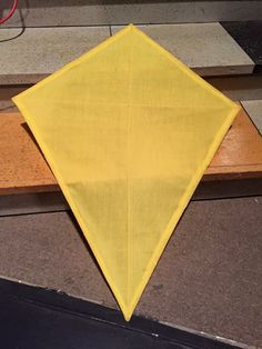 Show: Mary Poppins Prop: a kite  This is a front view of one of the diamond shaped kites. They were constructed with cotton fabric, small dowel rods, and a hot glue gun.