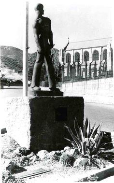 """The Copper Miner statue, also known as the """"Iron Man,"""" in Bisbee, Arizona around 1935-1940.  This image is from the photograph collection of the Bisbee Mining & Historical Museum."""