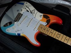 Hand painted USA American Fender Stratocaster. This is a 2005 Highway One USA American Fender Strat that was chosen specifically for this paint job because it features a vintage style bridge, new 50's style pickguard, and maple neck (just like the original)