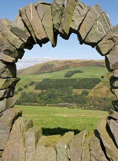 RAILSCOT | Drumlanrig Gorge | Framed by Andy Goldsworthy's sculpture Touchstone North, a Carlisle-Glasgow service threads though Drumlanrig Gorge near Ardoch farm.