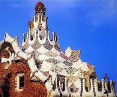 Gaudi- Park Guell- Detail of a craned roof covering in ceramics Empire State Building, Antonio Gaudi, Parc Guell, Dancing Cat, Roof Covering, Taj Mahal, Most Beautiful Cities, Barcelona Spain, Magnum Opus