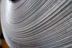 Steel Coil Close-Up. A close-up of the end of a steel coil. Close Up, Stainless Steel, Stock Photos, Kitchen Appliances, Business, Cards, Diy Kitchen Appliances, Home Appliances, Store