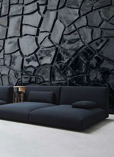 Dark textured wall with dark blue sofa #textures #fabrics #moodboard wood, metal, textures inpirations. See more at http://www.brabbu.com/en/inspiration-and-ideas/category/materials
