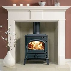 The Dovre 500 wood burner has the classic stove appeal. Made from premium grade cast iron, this traditional stove features up-to-date technology as well as the benefit of a separate ashpan door for easier removal of ash. Marble Fireplace Surround, Fireplace Surrounds, Fire Surround, Wood Furniture Living Room, Wood Pallet Furniture, Log Burning Stoves, Wood Burning, Simple Fireplace, Cosy Fireplace