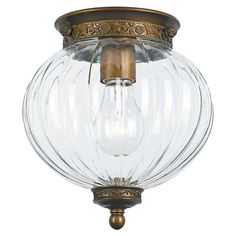 Cast a warm glow in your entryway or den with this lovely flush mount, showcasing 1 lights and an acrylic shade.   Product: Flush mo...