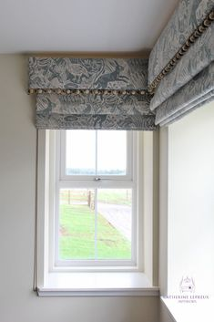 Inspiration on how to dress two windows at right angles to each other.  Roman blinds with matching pelmets maximise the light and keep the lines clean and simple..