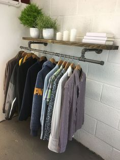 A handmade urban industrial shelf and garment rack / coat rack / clothes rail suitable for the home or in a retail space. The clothes rack has a simple, elegant and efficiant design allowing many item Open Clothes Storage, Clothes Rail With Shelves, Clothing Storage, Coat Storage Small Space, Wall Clothing Rack, Kids Clothing, Industrial Bedroom, Industrial Shelving, Urban Industrial