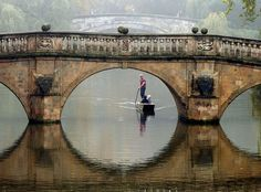 Fog lingers in the air as a punt makes its way along the River Cam in Cambridge, England on Oct. 22, 2012.  [Credit: Chris Radburn/AP]