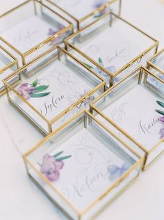 Vintage glass boxes: http://www.stylemepretty.com/2016/01/18/unique-wedding-escort-card-displays/: