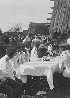 Empress Alexandra Feodorovna enjoying a meal with officers