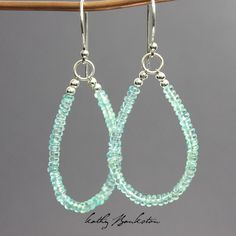 Handmade earrings featuring gorgeous pool water blue Apatite beads strung with Sterling Silver Beads. Simply stunning! They are the perfect earring for Summer! The ear wires and all findings are sterl