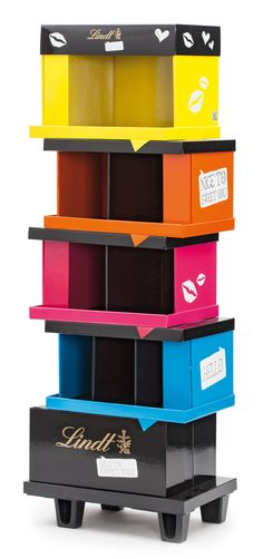 lindt display -- a stand plus multi colored boxes = great display-- something to think about when designing your outer boxes/ master cases!