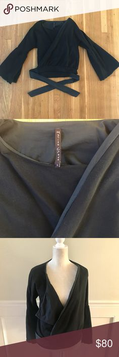 Manila Grace Made in Italy Wrap Jacket Top Black 2 Very good pre owned condition. Bell sleeve wrap jacket/top can be worn several different ways. Fully lined. Size 2. Made in Italy. Manila Grace Jackets & Coats
