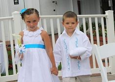 So adorable! We love how the embroidery on the shirt matches the flower girl's dress.    View our photo gallery on our website for more customer photos!