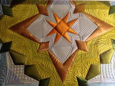 you can always quilt it first and then use Paintstiks to paint it! Angela Walters did that for her Legacy quilt