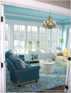 Lovely color in this room......love the rug~