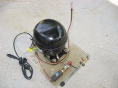 Vacuum Pump by richpin06 -- Homemade vacuum pump constructed from a surplus refrigerator compressor, tubing, and valves. http://www.homemadetools.net/homemade-vacuum-pump-10
