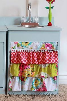 besides it being a cute play kitchen, i love the ruffled curtain idea for below our laundry room sink