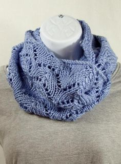 Stay warm and cozy this winter with this cowl knitted in horseshoe lace with a beautiful baby blue yarn.    Scarf can be worn short by wrapping in round the neck twice or long.     Knit in a super soft acrylic yarn, makes this cowl a pleasure to wear and also easy to care for.     The yarn is als...