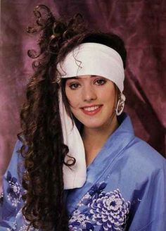 I'm thinking she had to wear that huge headband (or is it a towel?) to help support the weight of that massive sideways ponytail: | 25 Photos Of '80s Hairstyles So Bad They're Actually Good