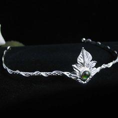 Elvish Woodland Leaf Circlet Wedding Headpiece with Natural Green Tourmaline Cabochon. camias, via Etsy.