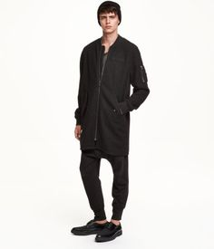 Long bomber jacket in a wool blend. H&M, Divided.
