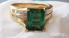 4 CT Emerald Cut Solitaire Ring Sold at Auction for $4,717
