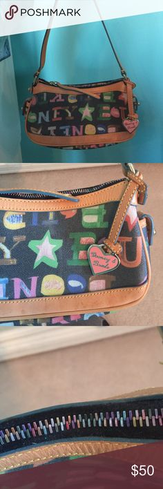Dooney & Burke Purse This purse is fun and playful! I mean did you see the pictures! Looking for a new and happy home for this cute purse! Dooney & Bourke Bags Mini Bags