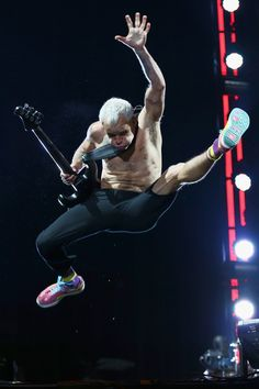 Flea will make you jump, jump. The Red Hot Chili Peppers bassist kicks it in the air during a performance at the Isle of Wight Festival 2014 on June 14 in Newport, Isle of Wight