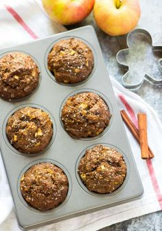 Healthy, moist Gingerbread Apple Muffins. Easy, delicious recipe made with whole wheat flour, coconut sugar, and warm holiday spices. Perfect breakfast recipe for Christmas morning, Thanksgiving, and last-minute holidays guests! #gingerbread #gingerbreadmuffins #healthy #easy #christmas #thanksgiving via @wellplated
