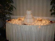 white reception lighting cake wedding