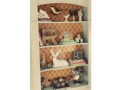 Wallpaper behind shelves is a great cost effective way to add color and pattern in a room. www.tiffanyleeanndesign.weebly.com