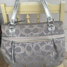 Authentic Silver Coach Poppy Gray Purse Tote Silver & Gray authentic Coach large poppy tote.  This bag is in great condition and from a smoke and pet free home.  We are moving, so I am posting my 100+ collection for the first time ever.  Most of it will be sold, only keeping a few pieces.  Check out my closet!  All items are guaranteed authentic and from a smoke and pet free home. Coach Bags Totes