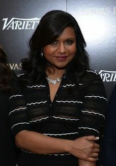 Actress, Mindy Kaling, from the Mindy Project, seen wearing a Saint Vintage Necklace and a pair of Love Drop Earrings.