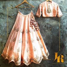 Buy peach with hegemonic embroidery & zari work designer lehenga choli online.This set is features a peach blouse in silk fully embellished with crystal, embroidery and sequins work.It has matching peach lehenga in raw silk with beautiful embroidery a Indian Gowns Dresses, Indian Fashion Dresses, Dress Indian Style, Indian Designer Outfits, Indian Outfits, Designer Dresses, Fashion Outfits, Indian Clothes, Indian Wear
