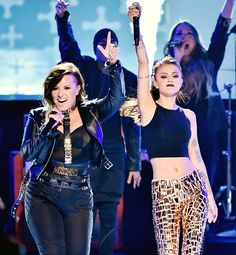 """Rock it out ladies! Demi Lovato and Cher Lloyd took the stage at the 2014 Teen Choice Awards to perform """"Really Don't Care,"""" which won Choice Summer Song."""