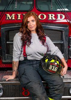 Firefighter senior portrait pose with helmet